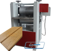 Wood plastic embossing machine
